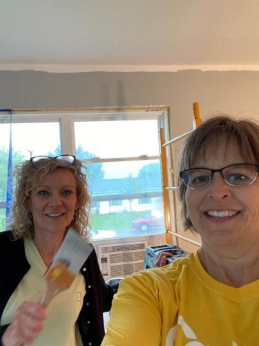 Lorri and Cheryl volunteering for Habitat for Humanity